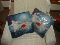 2 Coca-Cola polar bear pillows, as pictured.   Green Bay