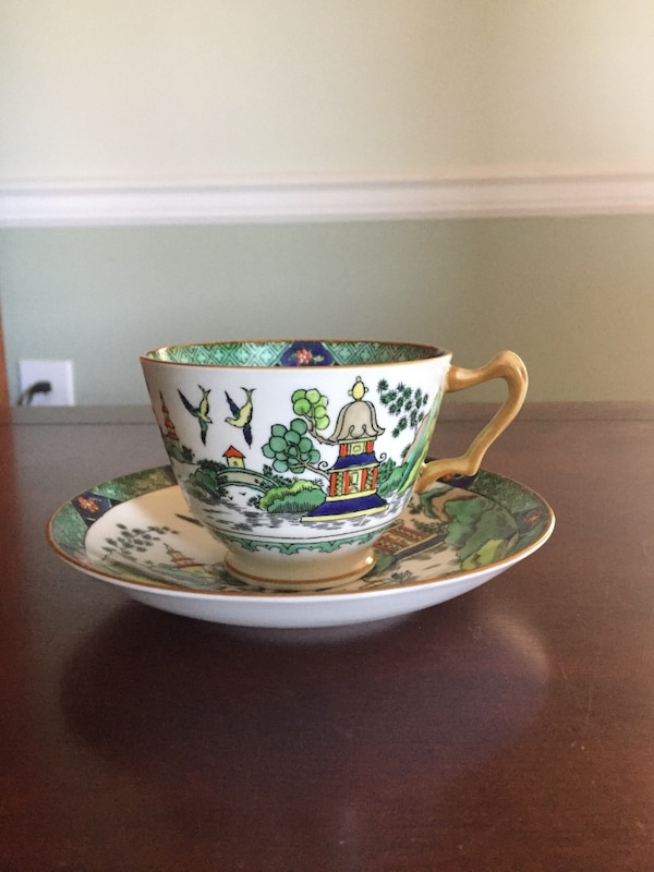White and green ceramic teacup
