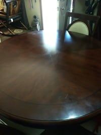 round brown wooden table with four chairs dining set Bryan, 77803