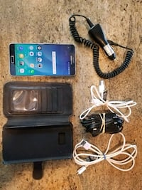 black Samsung Galaxy smartphone with charger and case Huntington Beach, 92649