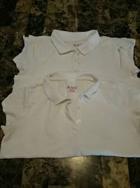 two beige Place polo shirts.