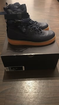 pair of black Nike Air Force 1 high Washington, 20011