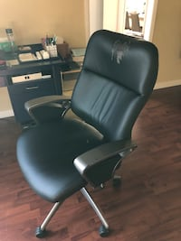 Black leather padded rolling desk chair