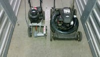 two black push mower and lawn endger