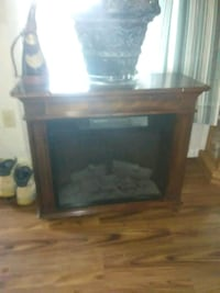 brown wooden framed electric fireplace Johnson City, 37604