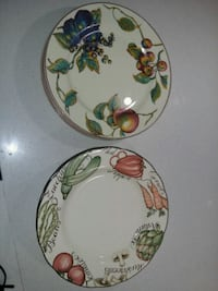 white, green, and red floral ceramic plate