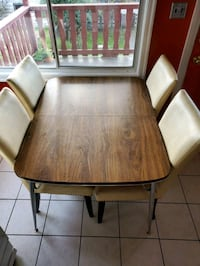 Dining table with 4 leather chairs  Vancouver, V5N 5H2