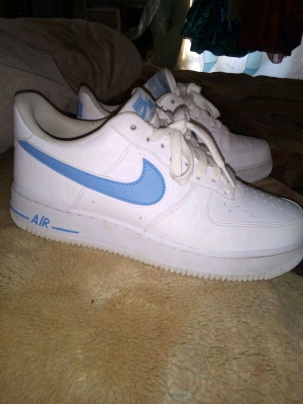 uk availability 2cbc6 84550 pair of white Nike Air Force 1 low