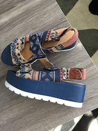 pair of white-blue-and-brown sandals
