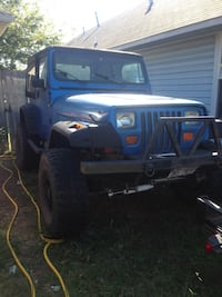 Blue and black Jeep