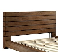 Brown wooden bed headboard , brand new in the box. Deer Park, 11729