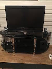 Black flat screen TV with black glass TV stand Springfield, 22153