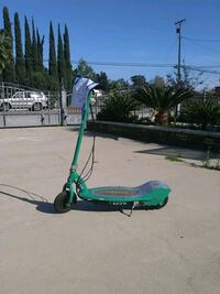 green and gray Razor electric kick scooter
