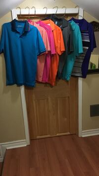 several assorted color polo shirts