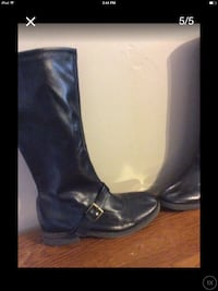 Black leather buckled strap boots Baltimore, 21206