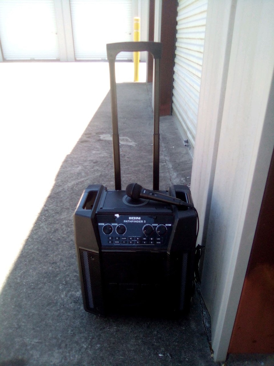 Photo Karaoke machine wheels n handle to tote it around with microphone