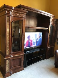 brown wooden TV hutch with flat screen television