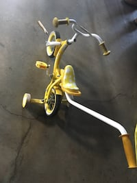 Yellow push bicycle with training wheels