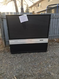 gray and black rear projection television