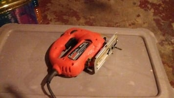 red corded hand power tool