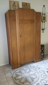 Brown wooden cabinet with mirror asking Bakersfield, 93309