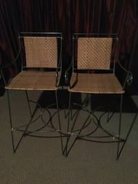 Two gray metal frame armchairs