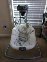 Graco swing with vibrating seat  and music.