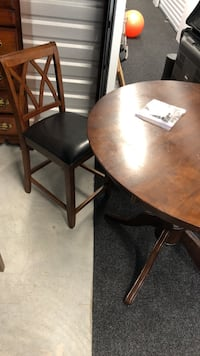 round tall dining table with four bar stools  Austin, 78741