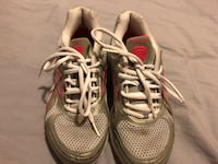 pair of gray-and-red running shoes
