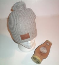 Corona Knit Toque and Combo Bottle Opener Koozie Corona Knit Toque with Leather Patch and Pom Pom London