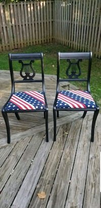 two black metal framed padded chairs 15 mi