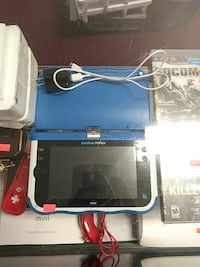 blue and black Vtech learning tablet computer
