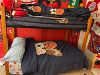 Black Iron and Light Oak Bunk Bed - full size bottom and single top. Mattresses not included
