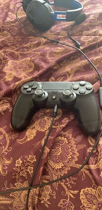 black Sony PS3 game console with controller Rockville, 20850