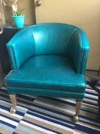 blue leather padded wooden armchair