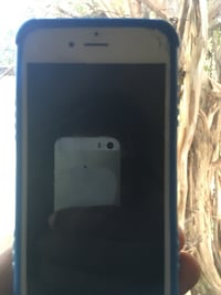 white iPhone 4 with black case Hickory, 28602