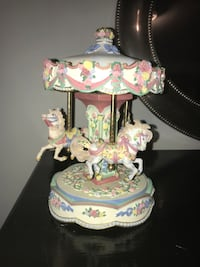 White and pink carousel figurine