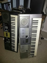 two gray and black electronic keyboards