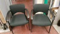 two black leather padded armchairs 549 km