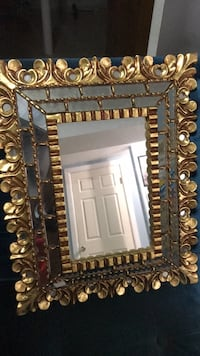 Brown wooden framed wall mirror New York