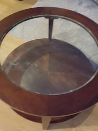 round brown wooden frame glass top table