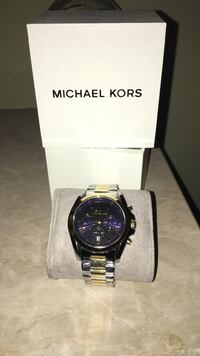 round black chronograph Michael Kors watch with gold and silver link strap Howell, 07731
