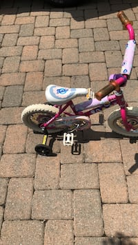 Toddler's red and black bicycle with training wheels