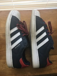 pair of black-white-and-red Adidas Superstar 52 km