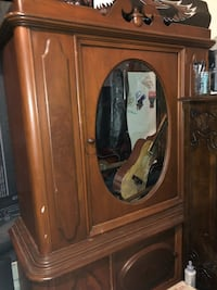 Tall cabinet  oval glass would look awesome painted ; and the inside redone London, N5Y 1K5