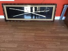 Collectible sword in a glass box case