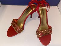 New red sequenced heel shoes size 8.5
