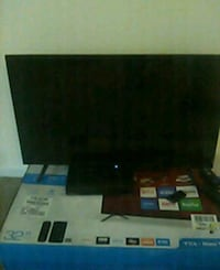 black flat screen TV with remote 2218 mi