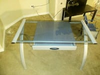 gray and black metal framed glass-top table 2283 mi