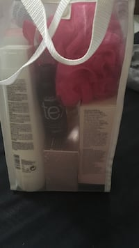 L'Oreal cosmetic set with white mesh bag